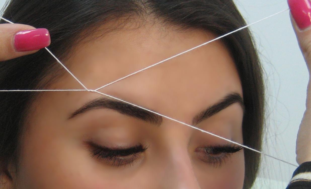 Удаление волос брови ниткой
